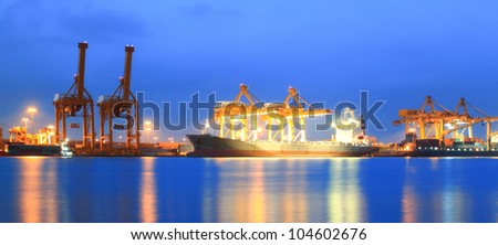 Containers loading at sea trading port Panorama