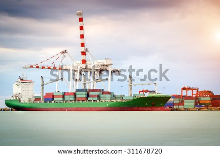 Containers loading by crane in the morning Trade Port Shipping