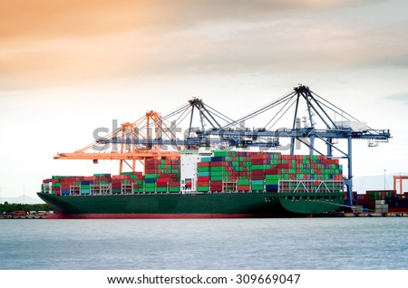 Containers loading by crane in the morning , Trade Port , Shipping , transport