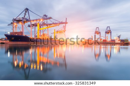 Containers loading Shipping by crane at morning or Trade Port