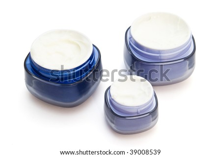 containers of different cosmetic creams isolated with clipping path