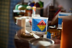 Containers with flammable liquids. Close up of containers with flammable liquids. Artists workshop.
