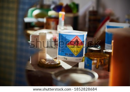 Containers with flammable liquids. Close up of containers with flammable liquids. Artists workshop.  Foto stock ©