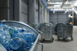 Containers with used bottles of drinks. Trash delivered to the factory for recycling.
