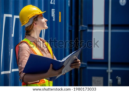 Containers woman worker using Folders file to inspection Containers box . female foreman Check inventory by Documents at warehouse logistic in Cargo freight ship for import export. shipping  Photo stock ©