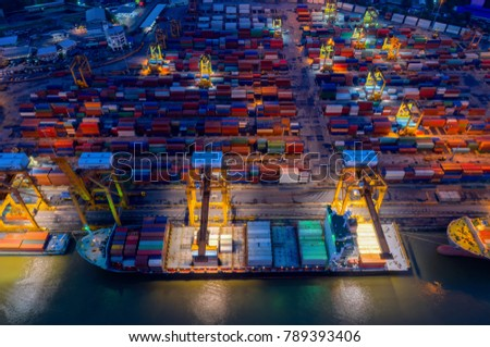 Containers yard in port congestion with ship vessels are loading and discharging operations of the transhipments in international port.