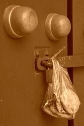containing food plastic bag hang at the door, beijing, china