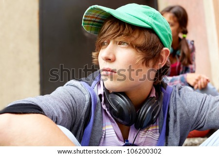 Contemplating teenager spending time outdoors in summer