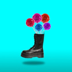 Contemporary art collage. Concept black boot with lollipops on a color background.