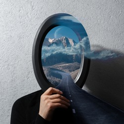 Contemporary artwork collage concept. Man holding black frame on face with beautiful landscape of cloudy mountains and asphalting road.