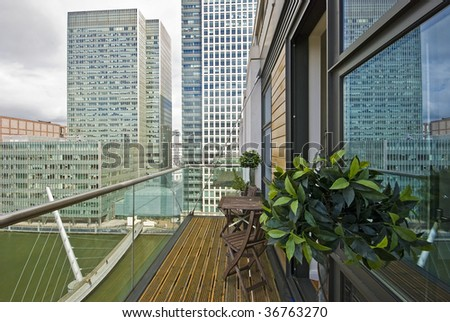contemporary balcony overlooking canary wharf and docks