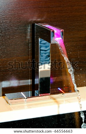 Contemporary bathroom faucet with temperature LED light