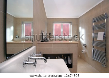 Contemporary bathroom with focus on taps