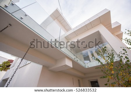 Contemporary beautiful modern white house exterior #526833532