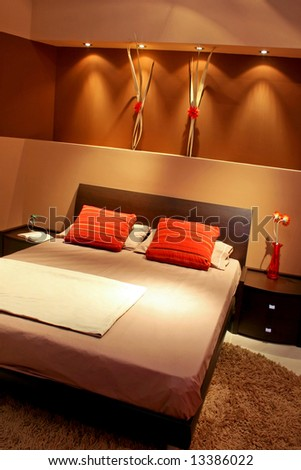 Contemporary brown bedroom with double bed and pillows