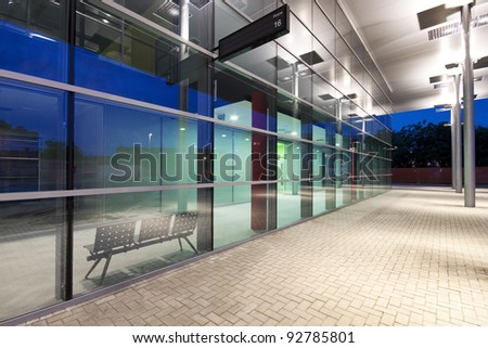 Contemporary bus station exterior at night