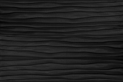 Contemporary carved wavy black leather pattern