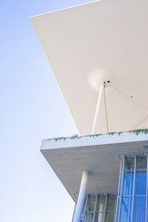 contemporary concret building with light flying roof on thing colums cable-stazed subilised