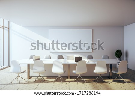 Contemporary conference interior with laptop and blank poster on wall with city view. Workplace and corporate concept. 3D Rendering