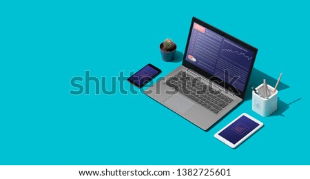 Contemporary corporate business desktop with laptop and isometric objects, finance and trade concept #1382725601