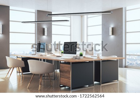 Contemporary coworking office interior with computers and city view. Workplace and lifestyle concept. 3D Rendering Foto stock ©