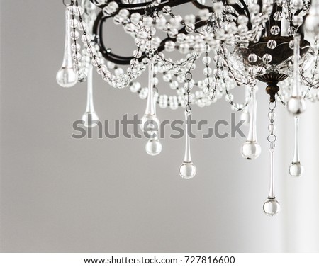 Contemporary crystal chandelier in room interior. Close up