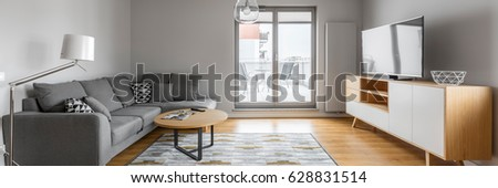 Contemporary designed living room with window door to the terrace, panorama #628831514