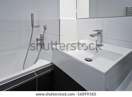 contemporary designer bathroom appliances in minimalist style - stock photo