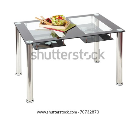 contemporary dining table with glass top and under shelves stock photo