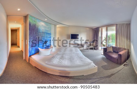 Contemporary elegant bedroom with big bed