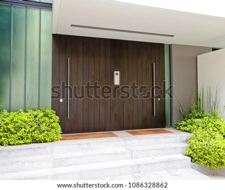 contemporary elegant house entrance dark wood door, Athens Greece