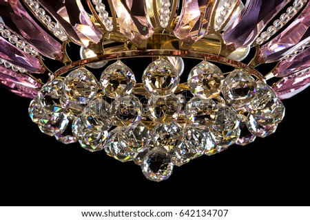 Contemporary Gold Chandelier Isolated On Black Background Crystal Decorated Pink Crystals Close Up