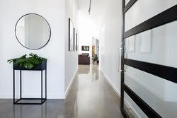 Contemporary home entry hall with polished concrete floors