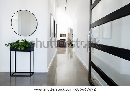 Contemporary home entry hall with polished concrete floors #606669692