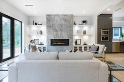 Contemporary home with open concept living and bright white decor