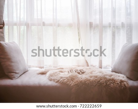 contemporary interior of Living room with part of sofa in sunny day and white curtain interior background concept