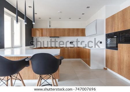 Contemporary kitchen in classical style with loft details. Luxury apartment downtown. Breakfast zone in comfortable brand new apartment.  #747007696