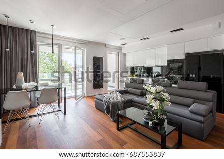 Contemporary living room with gray sofa, table and balcony #687553837