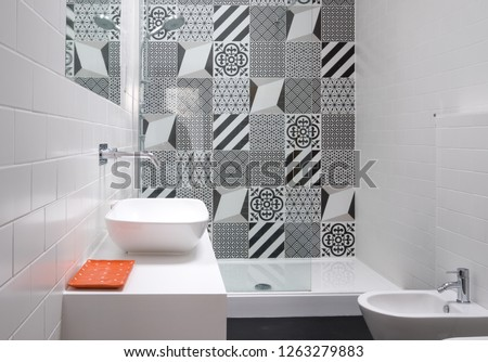 Contemporary loft bathroom with walk in shower unit and black and white monochrome porcelain wall tiles. #1263279883