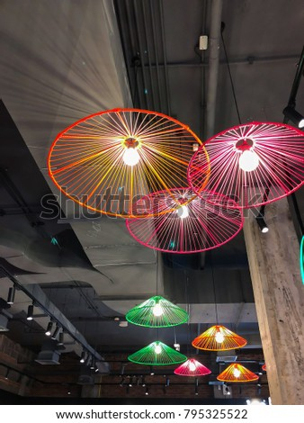 Contemporary loft style ceiling lamp. Interior decorating concept. Selective focus.