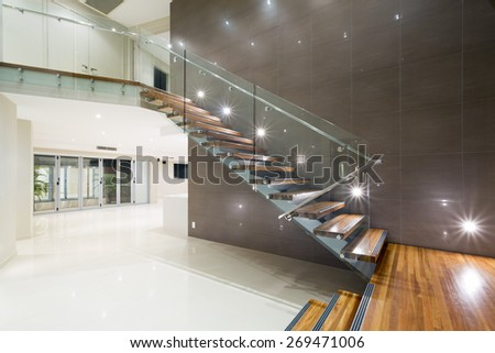 Contemporary mansion with wooden staircase #269471006