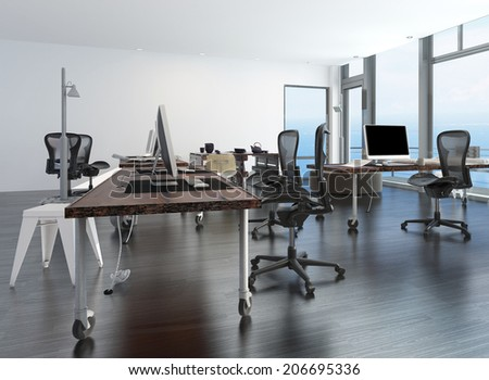 Contemporary minimalist office interior with workstations set up on a movable table and a floor-to-ceiling glass window overlooking the ocean