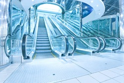 contemporary moving escalator stairs inside business blue hall