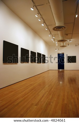 Contemporary museum gallery interior, blank paintings and photographs