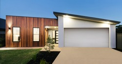 Contemporary new Australian home lighting at dusk