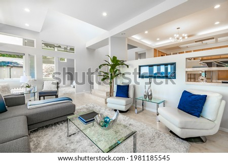 Contemporary Pacific Northwest Home with blue sky and water views bright white interior Foto stock ©