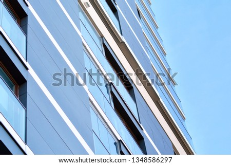 Contemporary residential building exterior in the daylight #1348586297