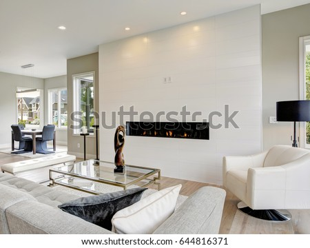 Shutterstock Contemporary style living room accented with modern fireplace encased in white tile surround. Northwest, USA