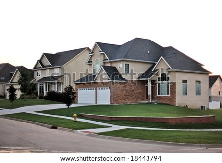 Contemporary suburban neighborhood home on a corner lot subdivision