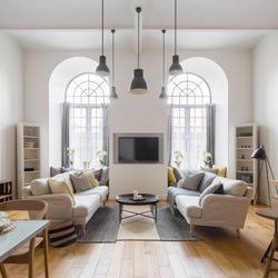 Contemporary tv living room with two sofas and two big arch windows